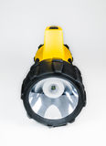 Big yellow flashlight hand held with adjustable angle isolated on white background.. Royalty Free Stock Images