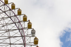 Big yellow funfair ferris wheel. With clouds sky background Stock Images