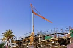 Big yellow hoisting crane Royalty Free Stock Image