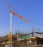 Big yellow hoisting crane Stock Images