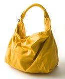 Big yellow leather handbag Stock Images