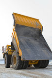 Big yellow mining truck. A picture of a big yellow mining truck at worksite Stock Image
