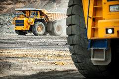 Big yellow mining truck. Belaz. Siberia, Russia - June, 2015: Big yellow mining truck groundmoving in Russia Stock Images
