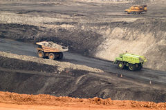 Big yellow mining truck and bulldozer at work industry site Stock Photos