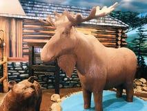 A big yellow moose statue royalty free stock photos