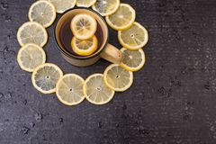 Lemon tea on a black background Royalty Free Stock Photos
