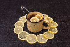 Lemon tea on a black background Stock Images