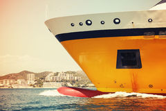 Big yellow passenger ferry ship goes on speed, toned Stock Photos