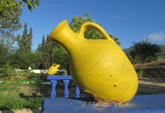 Big yellow pot as outside decoration in the yard Royalty Free Stock Photography