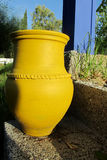 Big yellow pot as outside decoration in the yard Royalty Free Stock Photos