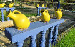 Big yellow pot as outside decoration in the yard Stock Photography