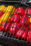 Big yellow and red pepper halves fried on a grill. Barbecue grill with yellow and red peppers stock photo