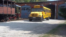Big yellow school bus parking. Big yellow school bus reverse parking in the Museum of Industry and Railway in Silesia, Jaworzyna Slaska, Poland stock video