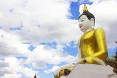 Big Yellow sitting Budha image and Blue sky Stock Photo