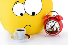 Big yellow smile, a cup of coffee and an alarm clock Stock Image