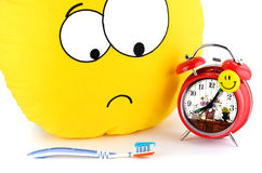 Big yellow smiley, toothbrush and an alarm clock Stock Images