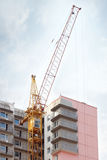 Big yellow stationary hoist and part of building Royalty Free Stock Images