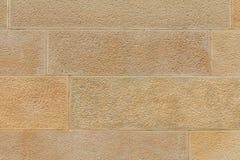 Big yellow stone wall close up Royalty Free Stock Images