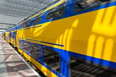 Big yellow train at a Dutch railway station Stock Images