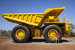 Big yellow transporter. An image of a big yellow transporter and a man in front of a wheel royalty free stock photo
