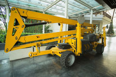 Big yellow truck crane. Yellow truck crane parked in shopping mall ready to repair Stock Images