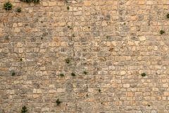 Big yellow wall from stone bricks stock image