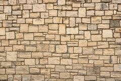 Big yellow wall from stone bricks royalty free stock photography