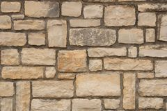 Big yellow wall from stone bricks stock photos