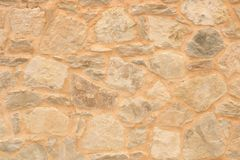 Big yellow wall from stone bricks royalty free stock images