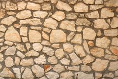 Big yellow wall from stone bricks royalty free stock photo