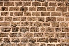 Big yellow wall from stone bricks stock photo