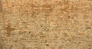 Big yellow wall from stone bricks stock photography