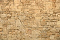 Big yellow wall from stone bricks stock images
