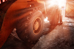 The big yellow wheel of heavy tractor. Royalty Free Stock Images