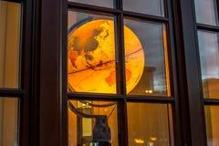 The Big Yellow World. The glowing globe behinde a retro window Stock Photos