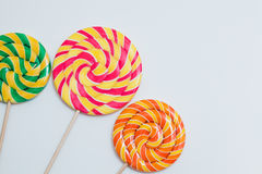 Big yummy lollipops on sticks. Sweet caramel candy on white. Cop Stock Image