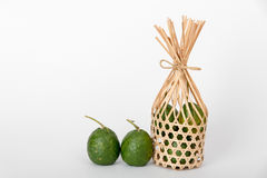 Bigarade oranges in round bamboo basket bigarade oranges. Bigarade oranges in round bamboo basket and one bigarade orange on white background stock photos
