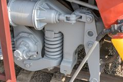 Bigger details on the old steam locomotive. Heavy iron parts. Locomotive in parts. Close-up. Bigger details on the old steam locomotive. Heavy iron parts stock photo
