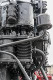 Bigger details on the old steam locomotive. Heavy iron parts. Locomotive in parts. Close-up.  royalty free stock photo