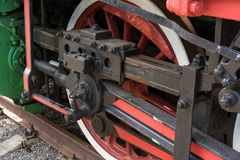 Bigger details on the old steam locomotive. Heavy iron parts. Locomotive in parts. Close-up stock image
