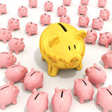 Bigger golden piggy bank Royalty Free Stock Image