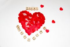 Bigger red heart beside white cubes with black letters Stock Photo