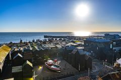 Hastings FIshing Quarter, in East Sussex, England. This is the biggest beach launched fishing fleet in Europe with its ancient tall black net huts and artists royalty free stock photo