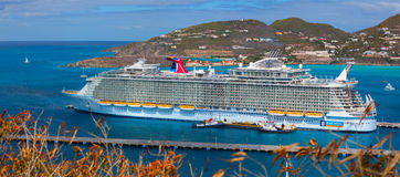 The biggest cruise ship in the world was docked in the central terminal. Over 5,500 guests went out to visit Exotic Island. royalty free stock image