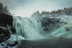 Biggest frozen swedish waterfall Tannforsen in winter time. Frozen waterfall Tannforsen. Winter scenery and ice forming on this biggest swedish waterfall royalty free stock photography