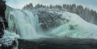 Biggest frozen swedish waterfall Tannforsen in winter time stock photography