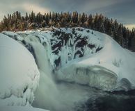 Biggest frozen swedish waterfall Tannforsen in winter time royalty free stock photos
