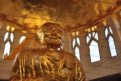 Biggest gold statue of Luang Pu Thuat , the holy and famous monk in the viharn. Viharn of Wat Sorapong In Nakhon Ratchasima or Korat , Thailand royalty free stock image