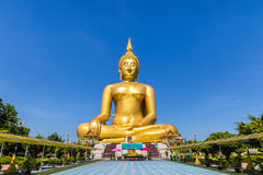 Biggest golden buddha statue on blue sky background Stock Photography