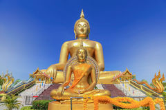 Biggest golden buddha statue in wat muang public temple at angthong province, thailand. On blue sky background Stock Photography